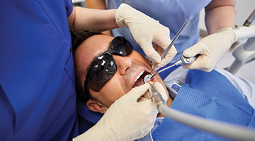 dentist working on man's smile
