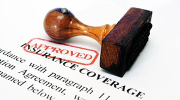 Approved stamp on insurance coverage form