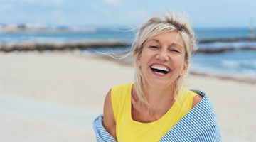 Woman smiling by beach