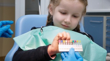 child chooses colored tooth filling