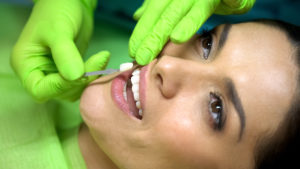 Patient being fitted with porcelain veneers
