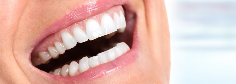 A person smiling with white teeth