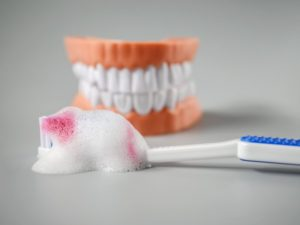 toothbrush with blood on it