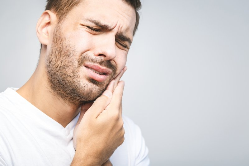 Man with toothache needing to see emergency dentist